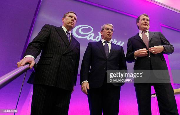 Cadbury's executives Chief Executive Officer Todd Stitzer Chairman Roger Carr and Chief Financial Officer Andrew Bonfield pose for photographs after...