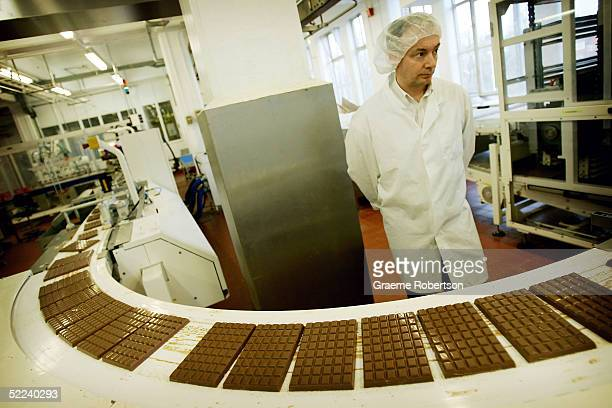 Cadbury's factory worker checks all the chocolate on the production line February 25 2005 in Birmingham England The company is celebrating 100 years...