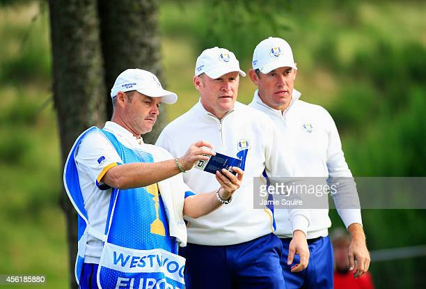 Caddie Billy Foster Jamie Donaldson and Lee Westwood of Europe in discussion during the Morning Fourballs of the 2014 Ryder Cup on the PGA Centenary...