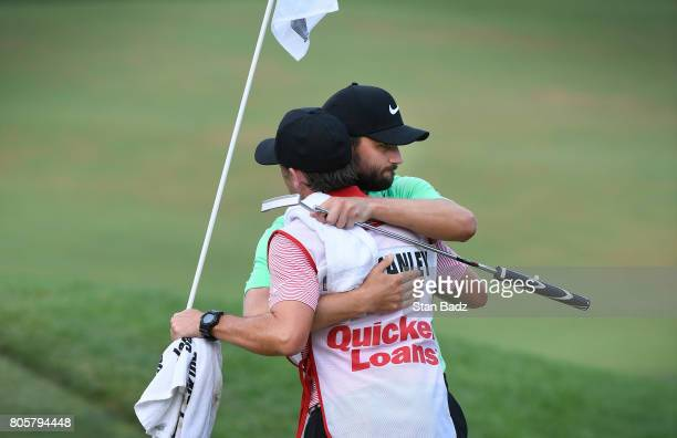 Caddie Brian Reed and Kyle Stanley celebrate their win after a playoff in the final round of the Quicken Loans National at TPC Potomac at Avenel Farm...