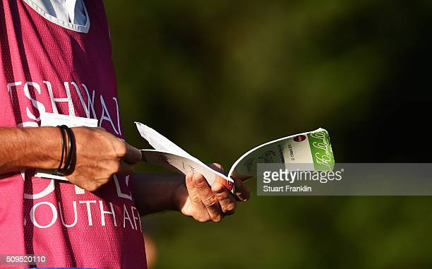 A caddie check the yardage during the first round of the Tshwane Open at Pretoria Country Club on February 11 2016 in Pretoria South Africa
