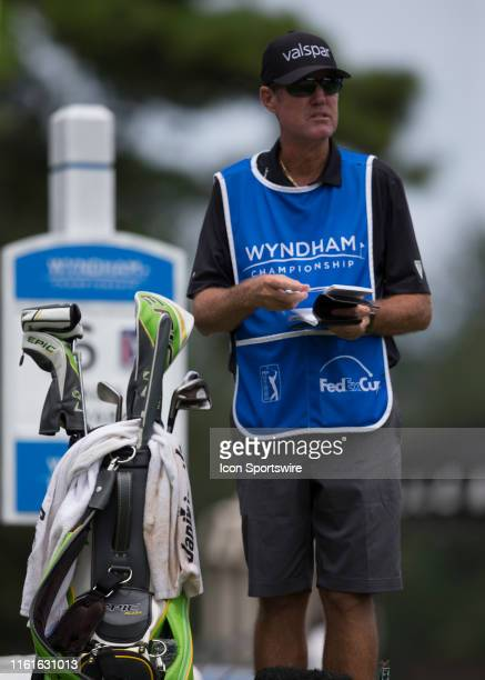 Caddie Don Donatello surveys the yardage form the 16th tee during the final round of the Wyndham Championship on August 04 2019 at Sedgefield Country...