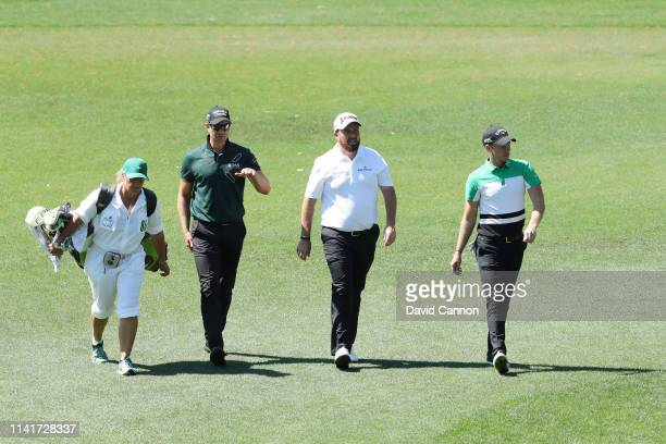Caddie Fanny Sunesson Henrik Stenson of Sweden Shane Lowry of Northern Ireland and Danny Willett of England walk during a practice round prior to the...