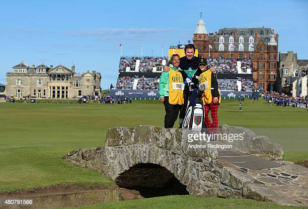 Caddie Fanny Sunesson Sir Nick Faldo of England and daughter Emma pose on the Swilcan Bridge during the Champion Golfers' Challenge ahead of the...