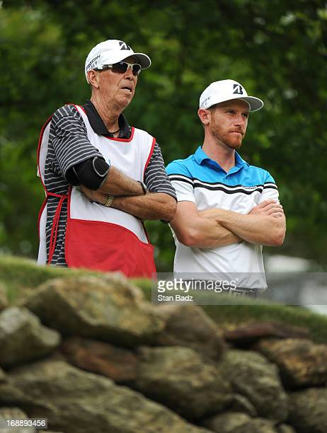 Caddie Jerry Higginbotham and Nick Flanagan watch play on the 11th hole during the first round of the BMW Charity ProAm Presented by SYNNEX...