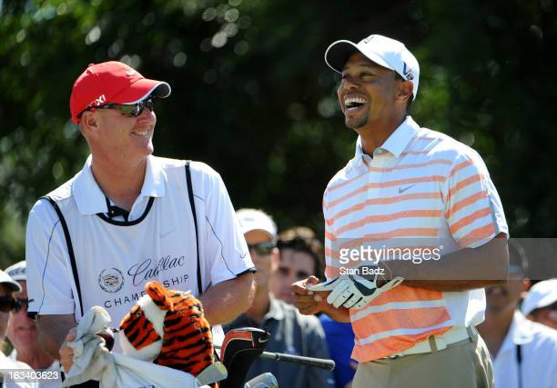 Caddie Joe LaCava and Tiger Woods laugh on the fifth hole during the second round of the World Golf ChampionshipsCadillac Championship at TPC Blue...
