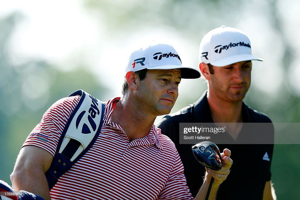 Caddie Keith Sbarbaro walks walks with Dustin Johnson during a practice round prior to the start of the 113th U.S. Open at Merion Golf Club on June 11, 2013 in Ardmore, Pennsylvania.