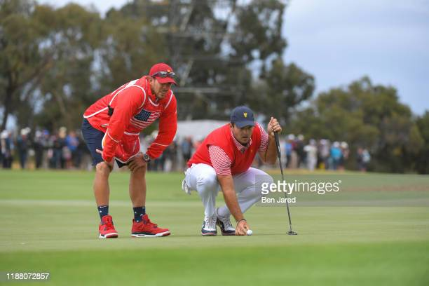 Caddie Kessler Karain and U.S. Teams Patrick Reed during the first round four-ball matches of the Presidents Cup at The Royal Melbourne Golf Club on...