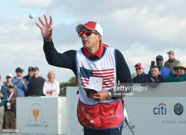 Caddie Kessler Karain catches a ball during the Saturday morning foursomes matches during the third round of the Presidents Cup at Liberty National...