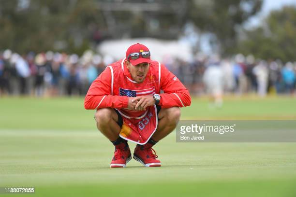 Caddie Kessler Karain during the first round four-ball matches of the Presidents Cup at The Royal Melbourne Golf Club on December 12 in Melbourne,...