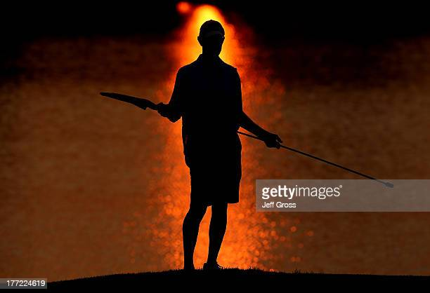 A caddie looks on during the first round of The Barclays at Liberty National Golf Club on August 22 2013 in Jersey City New Jersey