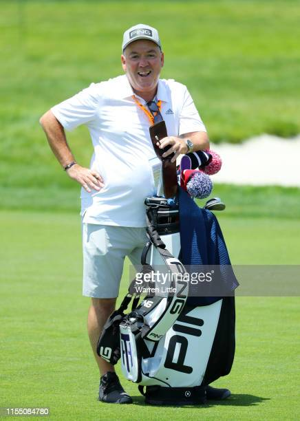 Caddie Mick Donaghy stands on the second hole during a practice round prior to the 2019 US Open at Pebble Beach Golf Links on June 10 2019 in Pebble...
