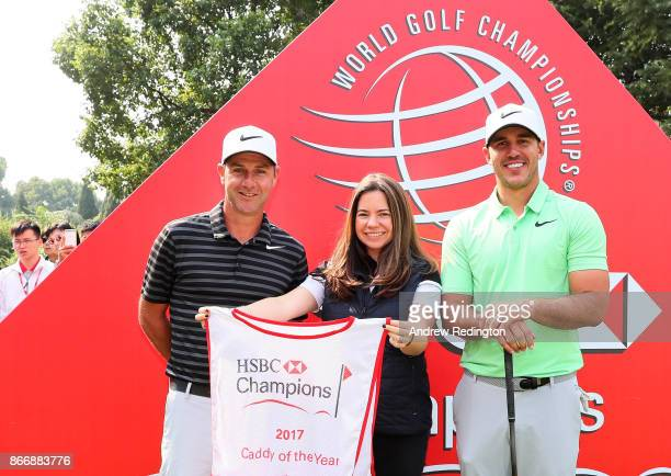 Caddie of the year 2017 Ricky Elliott poses with Brooks Koepka of the United States and Nicola Crowther Senior Manager Global Golf Strategy and...