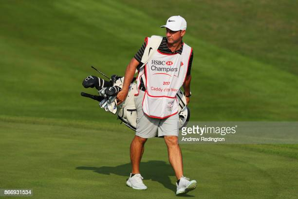 Caddie of the year Ricky Elliot caddie for Brooks Koepka of the United States walks during the second round of the WGC HSBC Champions at Sheshan...