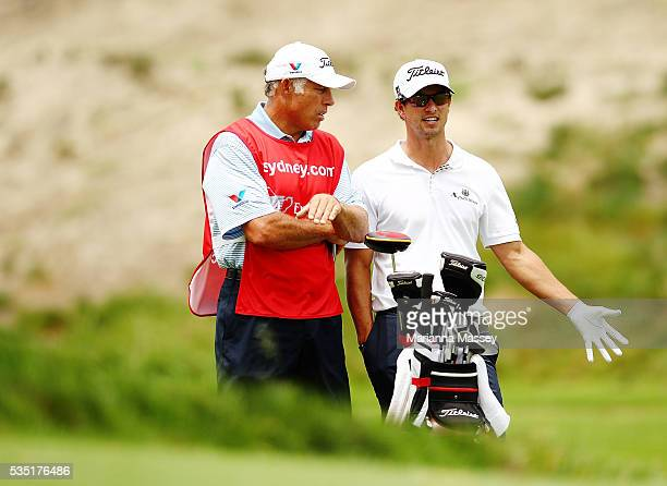 Caddie Steve Williams and golfer Adam Scott of Australia during day one of the 2011 Emirates Australian Open at The Lakes Golf Club at The Lakes Golf...