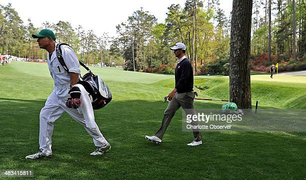 Caddie Steve Williams and golfer Adam Scott walk to the 14th tee box during a practice round at Augusta National Golf Club on Tuesday April 8 in...