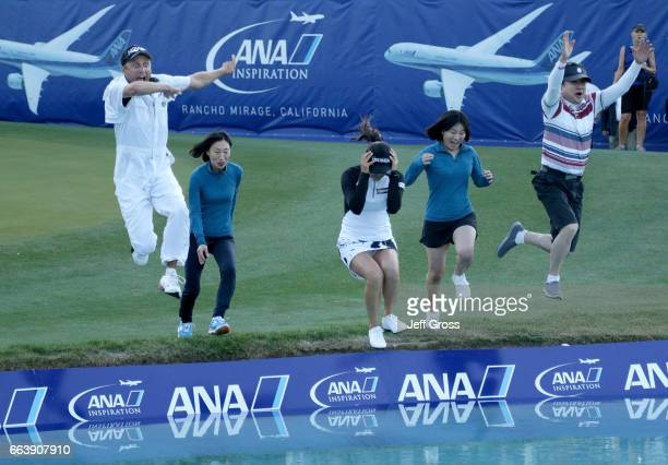 Caddie Tom Watson mother Kwung Ja Cho So Yeon Ryu sister Somyung Ryu and manager Sangjin Jang celebrate by jumping into poppie's pond after So Yeon...