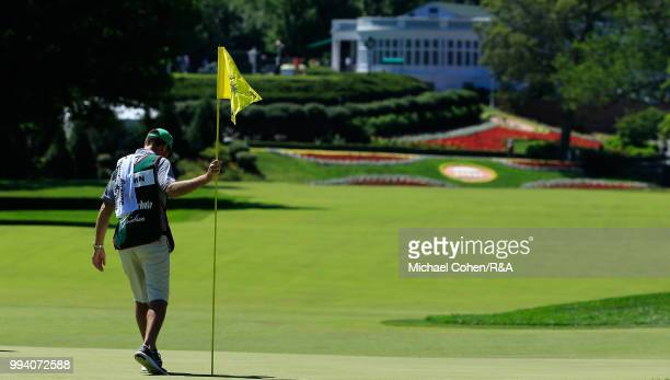A caddie works on the first green during the fourth and final round of A Military Tribute At The Greenbrier held on The Old White TPC on July 8 2018...