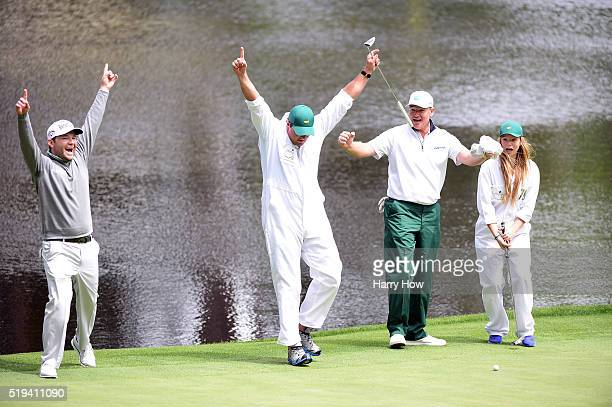 Caddie Zacharia Rasego celebrates putting with Branden Grace of South Africa and Ernie Els of South Africa during the Par 3 Contest prior to the...