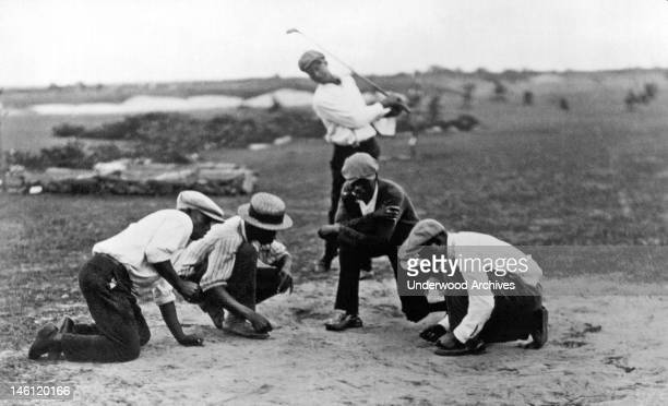 Caddies at the Hialiah Country Club in Miami play the game known as 'African golf' where sevens are good and boxcars spell defeat Miami Florida early...