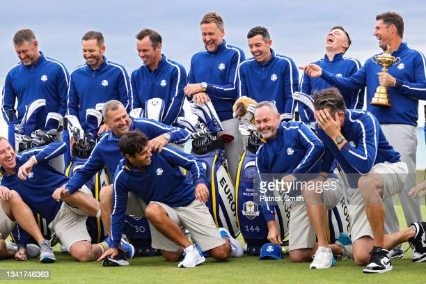 Caddies for Team Europe and players of Team Europe joke around as captain Padraig Harrington holds the Ryder Cup during a team photoshoot prior to...