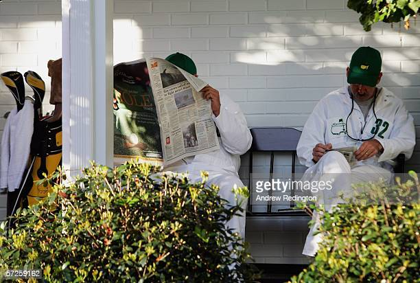 Caddies relax by the clubhouse during practice for The Masters at the Augusta National Golf Club on April 5 2006 in Augusta Georgia