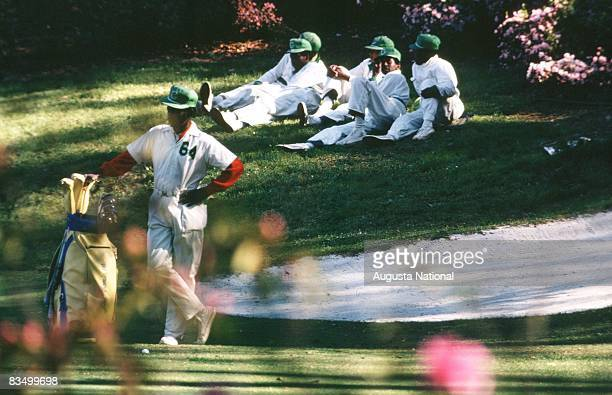 Caddies relax greenside and watch the action during the 1972 Masters Tournament at Augusta National Golf Club in April 1972 in Augusta Georgia