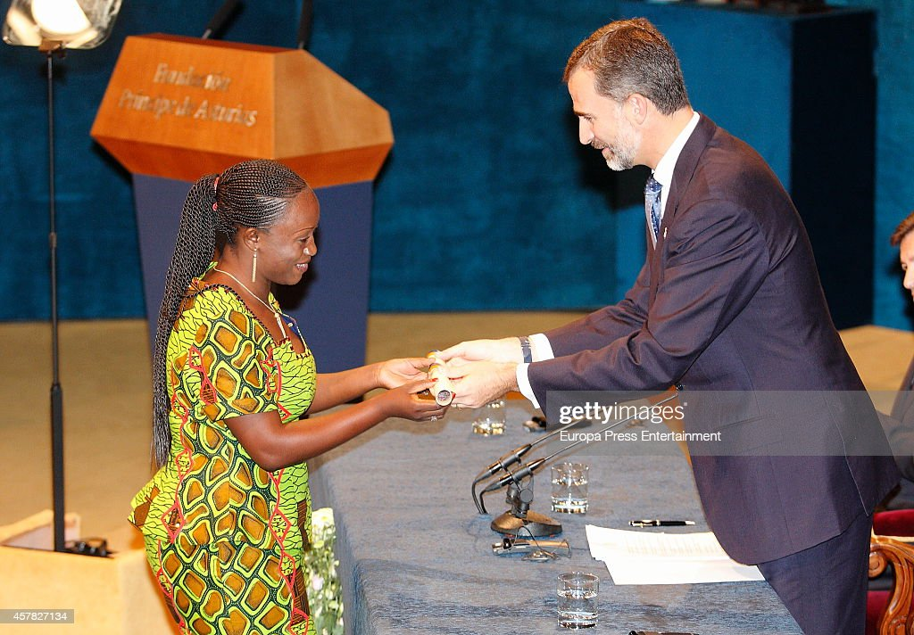 Caddy Adzuba receives the Prince of Asturias from King Felipe of Spain during Prince of Asturias Awards 2014 on October 24, 2014 in Oviedo, Spain.