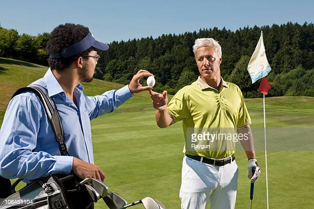 Caddy gives an egg to another golfer