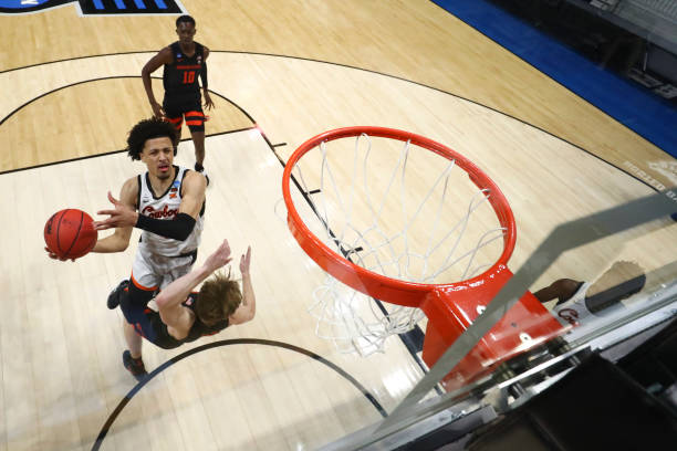 Cade Cunningham of the Oklahoma State Cowboys drives to the basket against an Oklahoma State Cowboys defender during the second half in the second...