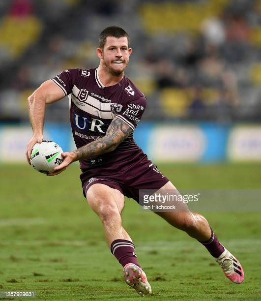 Cade Cust of the Sea Eagles runs the ball during the round 11 NRL match between the North Queensland Cowboys and the Manly Warringah Sea Eagles at...