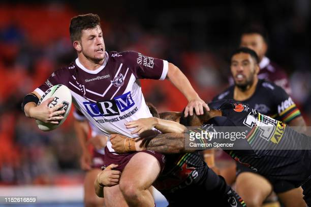 Cade Cust of the Sea Eagles runs the ball during the round 12 NRL match between the Penrith Panthers and the Manly Warringah Sea Eagles at Panthers...