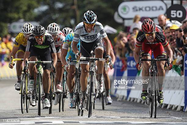 Cadel Evans of Australia and BMC Racing team battles to victory alongside Alberto Contador of Spain and team Saxobank Sungard during Stage 4 of the...