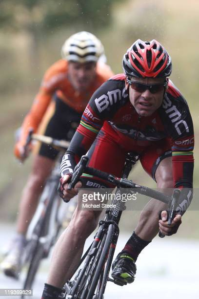 Cadel Evans of Australia and BMC Racing Team descends from the Col du Manse in front of Samuel Sanchez of Spain and team Euskaltel-Euskadi during...
