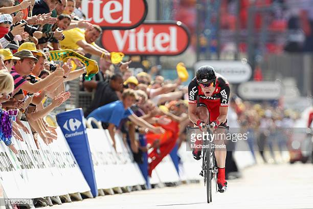 Cadel Evans of Australia and BMC Racing Team heads for the finishing line and records the second fastest time to take over the race leaders yellow...