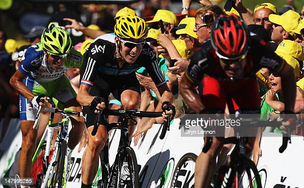 Cadel Evans of Australia and the BMC Racing Team leads Bradley Wiggins of Great Britain and SKY Procycling and Vincenzo Nibali of Italy and...