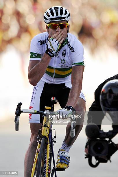 Cadel Evans of Australia celebrates after winning the elite men's road race of the UCI cycling road World Championships on September 27 2009 in...