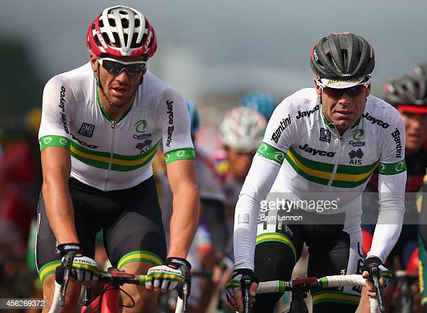 Cadel Evans of Australia rides with team mate Adam Hansen during the Elite Men's Road Race on day seven of the UCI Road World Championships on...