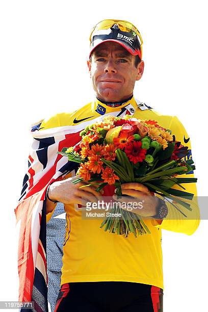 Cadel Evans of team BMC celebrates on the podium after winning the 2011 Tour de France after the twenty first and final stage of Le Tour de France...