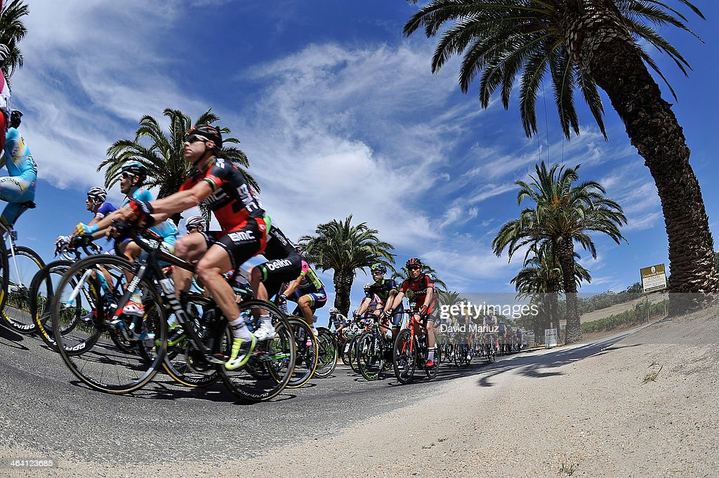 Cadel Evans (L) rides near the front of the Peleton during day two of the Tour Down Under on January 21, 2014 in Adelaide, Australia.