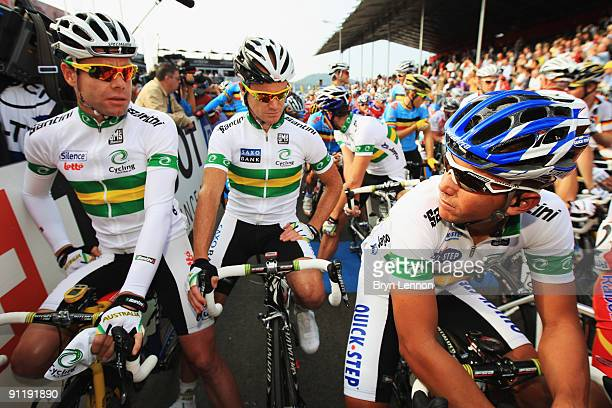 Cadel Evans, Stuart O'Grady and Allan Davis of Australia wait for the start of the Men's Road Race at the 2009 UCI Road World Championships on...