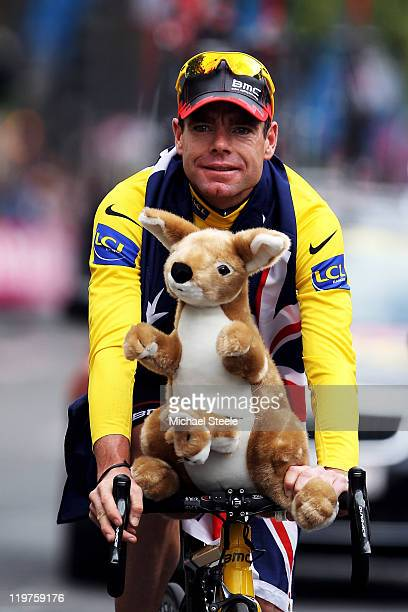 Cadel Evansof team BMC takes part in a victory parade after winning the 2011 Tour de France after the twenty first and final stage of Le Tour de...