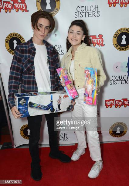 Caden Conrique and Dylan Conrique attend The Couch Sisters 1st Annual Toys For Tots Toy Drive held onNovember 20 2019 in Glendale California