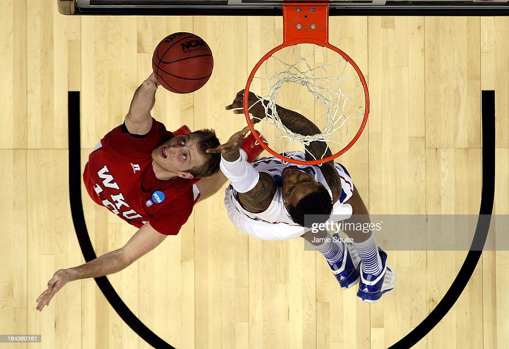 Caden Dickerson #10 of the Western Kentucky Hilltoppers grabs a rebound as Ben McLemore #23 of the Kansas Jayhawks defends during the second round of the NCAA Basketball Tournament at the Sprint Center on March 22, 2013 in Kansas City, Missouri.