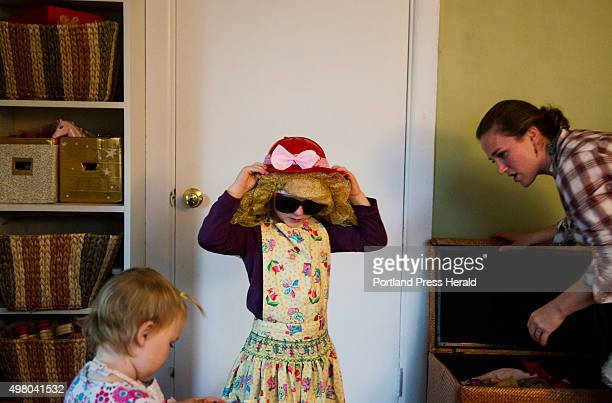 Cadence Kessler and her sister Lyla play dress up with their mother Jessie Kessler at their home in South Portland, ME on Monday, October 26, 2015.