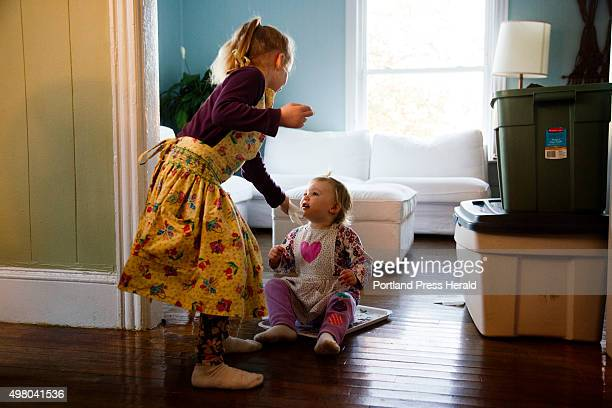 Cadence Kessler brings a tissue to her sister Lyla at their home in South Portland, ME on Monday, October 26, 2015.