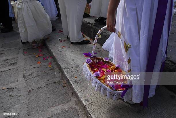 White dresses and baskets of petals at the Procession of 400 Christs.