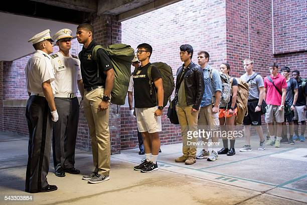 Cadet candidates receive orders from older cadets during the inprocessing procedures during Reception Day at the United States Military Academy at...
