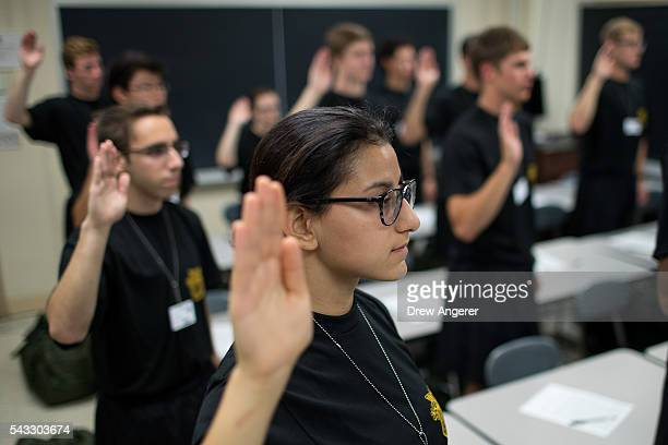 Cadet candidates recite the Oath of Allegiance during the inprocessing procedures during Reception Day at the United States Military Academy at West...