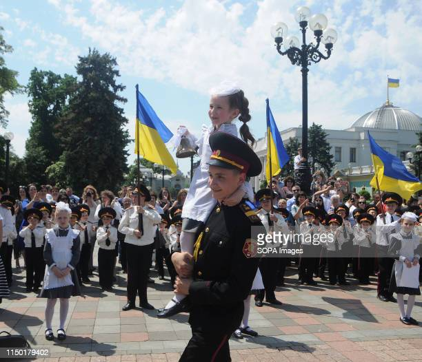 A cadet caries a pupil of an elementary school during the ceremony Holidaygraduation ceremony for the first Ukrainian cadet schoolchildren On this...